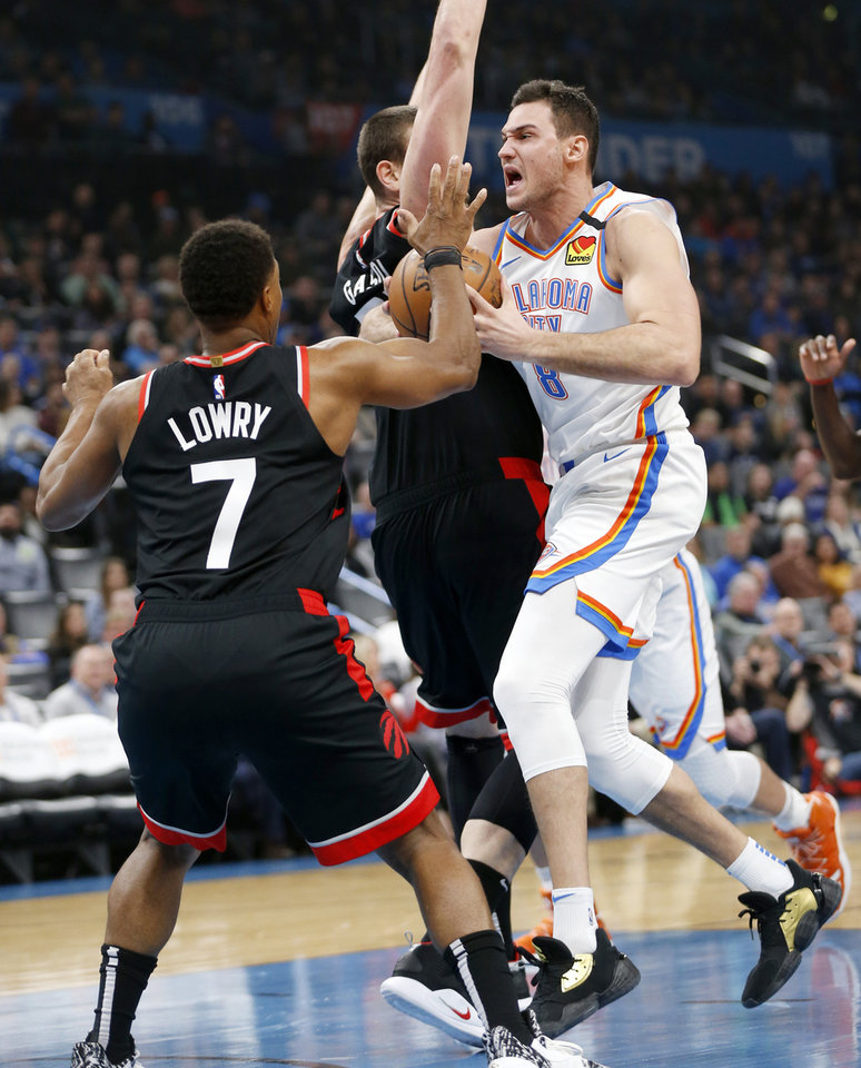 Photo - Oklahoma City's Danilo Gallinari (8) takes the ball to the basket as Toronto's Marc Gasol (33) and Kyle Lowry (7) defend in the first quarter during an NBA basketball between the Oklahoma City Thunder and the Toronto Raptors at Chesapeake Energy Arena in Oklahoma City, Wednesday, Jan. 15, 2020. [Nate Billings/The Oklahoman]