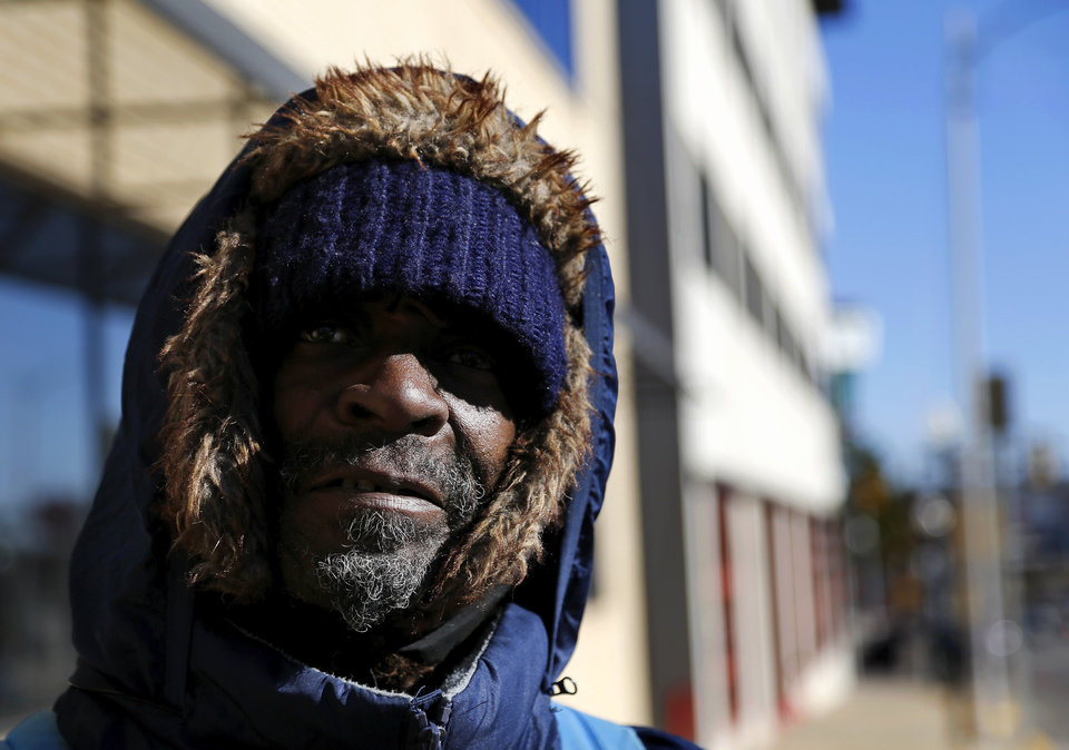 Photo - Calvin Lambert , a homeless man who spent last night in the shelter of a vacant building. Photographed as he walked on a downtown sidewalk, Lambert had just come from the Episcopal Church's St. George's Guild, where he received warm clothing, extra blankets and food as he deals with frigid sub-freezing temperatures, part of a major winter storm that continues to grip much of the central sections and the eastern half of the United States. Photo taken Monday, Jan. 6, 2014.  Photo by Jim Beckel, The Oklahoman