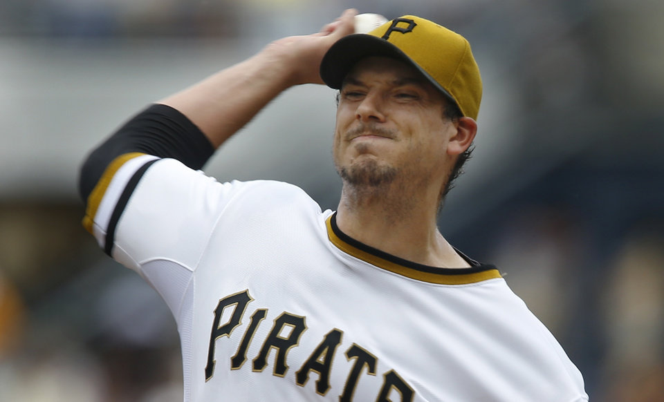 Photo - Pittsburgh Pirates starting pitcher Charlie Morton throws against the Milwaukee Brewers in the first inning of the baseball game on Sunday, June 30, 2013, in Pittsburgh. (AP Photo/Keith Srakocic)