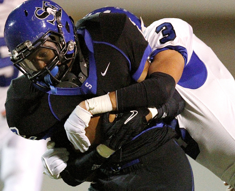 Deer Creek's Kyle Kanady tackles Southeast's Zachary Guesses during their high school football game at C.B. Speegle Stadium in south Oklahoma City on Thursday, September 29, 2011. Photo by John Clanton, The Oklahoman