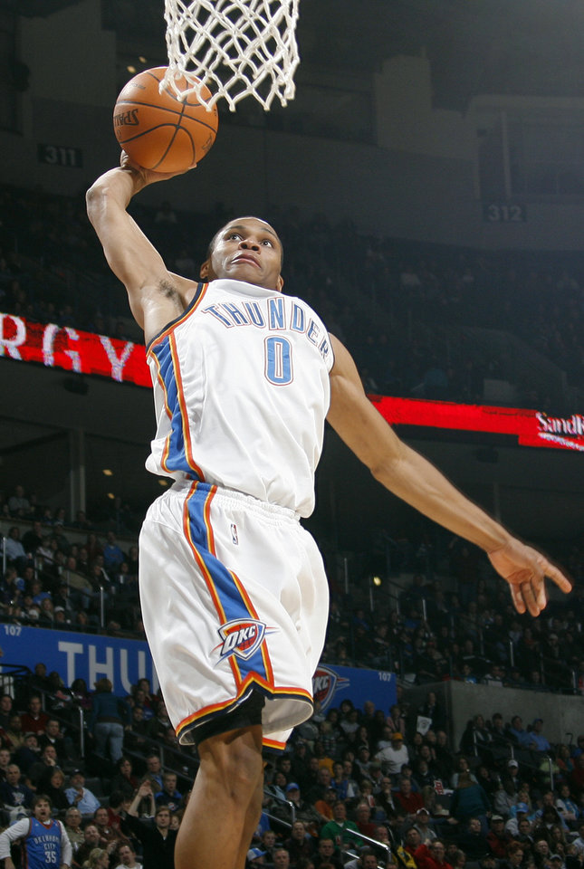 Photo - Oklahoma City's Russell Westbrook (0) dunks the ball during the NBA basketball game between the Oklahoma City Thunder and the Charlotte Bobcats at the Ford Center in Oklahoma City, Saturday, December 26, 2009. Photo by Nate Billings, The Oklahoman ORG XMIT: KOD