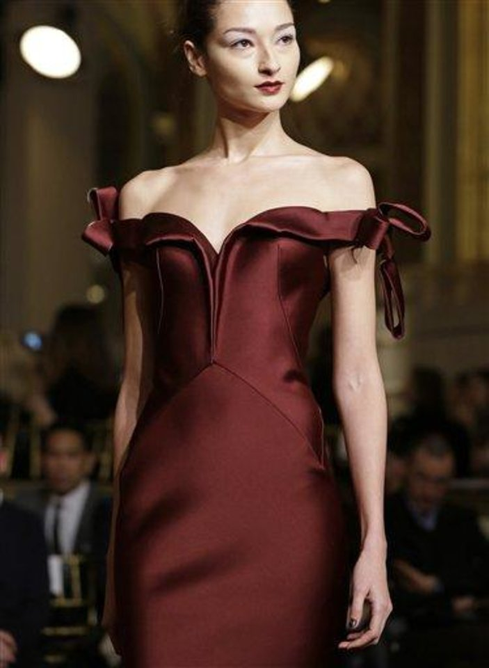 A model pauses during the Zac Posen Fall 2013 runway show at Fashion Week at the Plaza in New York, Sunday, Feb. 10, 2013.  (AP Photo/Kathy Willens)