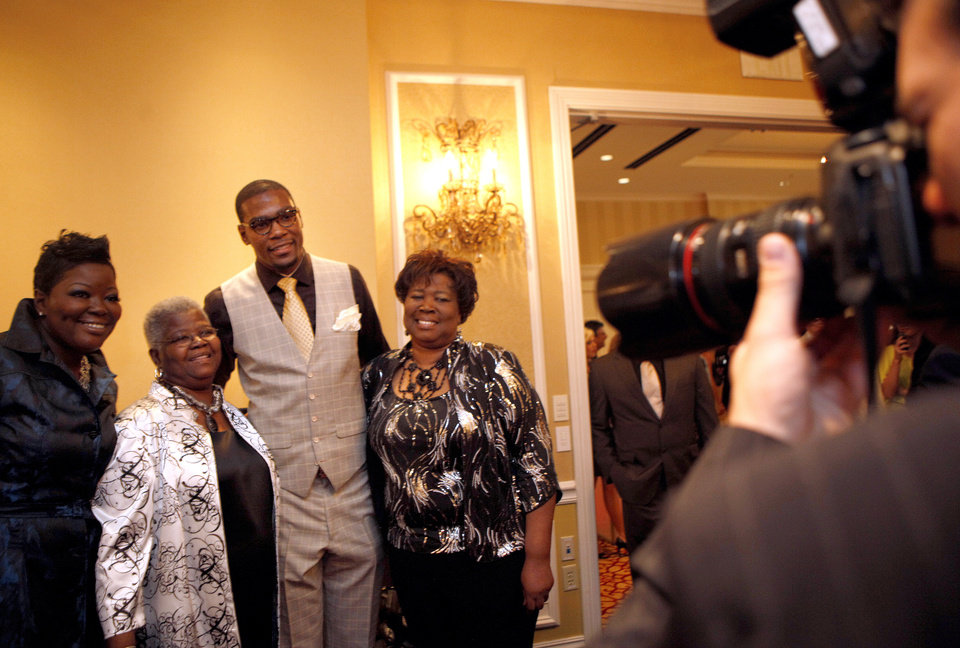Photo - Oklahoma City's Kevin Durant poses for a photo with his mom, Wanda Pratt, grand mother, Barbara A. Davis and aunt Michelle Ridgley during the KD 35 Ball benefiting the Kevin Durant Family Foundation at the Skirvin Hilton Hotel in Oklahoma City, Saturday, March 31, 2012. Photo by Sarah Phipps The Oklahoman