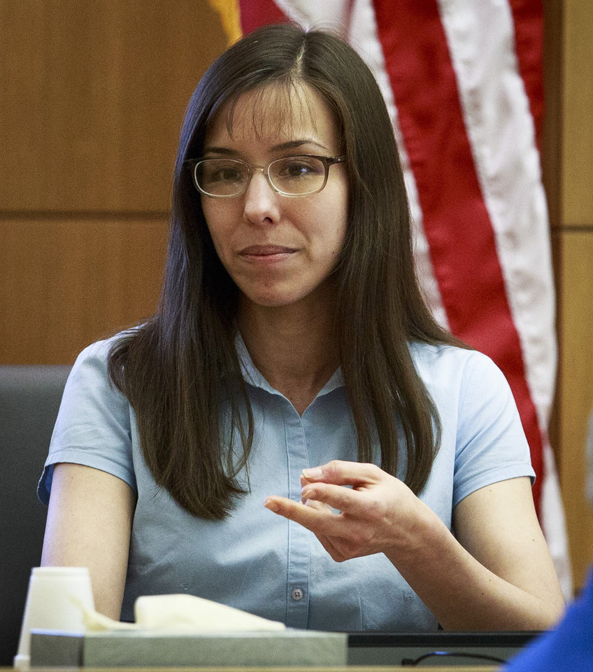 Photo - Defendant Jodi Arias testifies on her behalf during her murder trial in Judge Sherry Stephens' Superior Court in Phoenix, on Tuesday, Feb. 5, 2013. Arias is charged in the stabbing and shooting death of her lover. She first took the stand Monday in a case that has been peppered with lurid stories of sex, lies, betrayal and violence. (AP Photo/The Arizona Republic, Charlie Leight)
