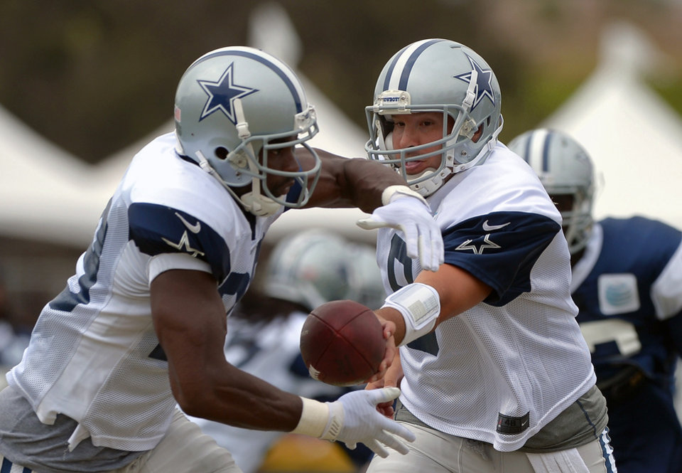 Get used to this sight. Former Oklahoma standout DeMarco Murray will likely be Dallsa' feature back this season. Here, he's pictured taking a hand off from Cowboys quarterback Tony Romo. (AP Photo/Mark J. Terrill)