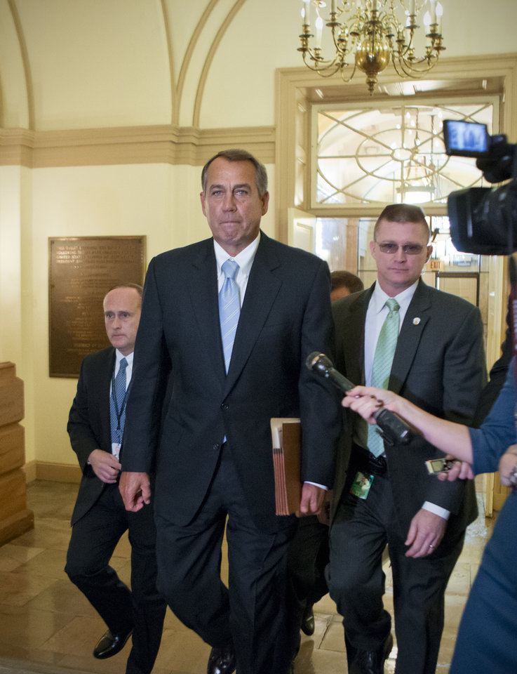 Photo - House Speaker John Boehner of Ohio arrives on Capitol Hill in Washington, Friday, March 1, 2103, after a meeting at the White House between President Barack Obama and Congressional leaders before billions of dollars in mandatory budget cuts were to start. The meeting — lasting less than an hour — yielded no immediate results. (AP Photo/J. Scott Applewhite)