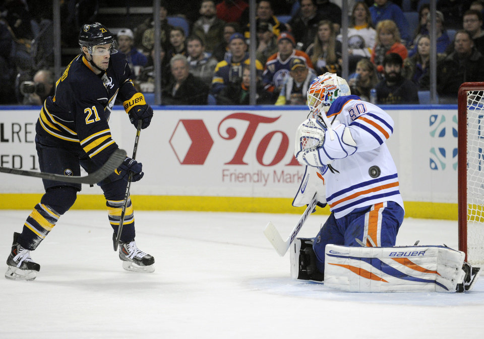 Photo - Buffalo Sabres right winger Drew Stafford (21) watches his shot deflect off Edmonton Oilers goaltender Ilya Bryzgalov (80), of Russia, during the first period of an NHL hockey game in Buffalo, N.Y., Monday, Feb 3, 2014. (AP Photo/Gary Wiepert)