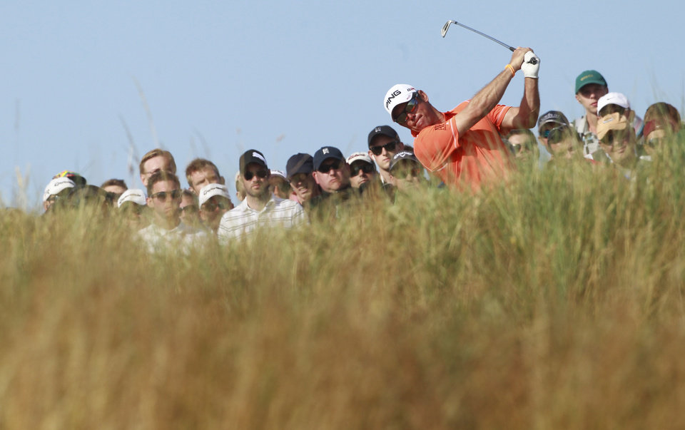 Lee Westwood of England plays a shot off the 14th tee during the third round of the British Open Golf Championship at Muirfield, Scotland, Saturday July 20, 2013. (AP Photo/Peter Morrison)