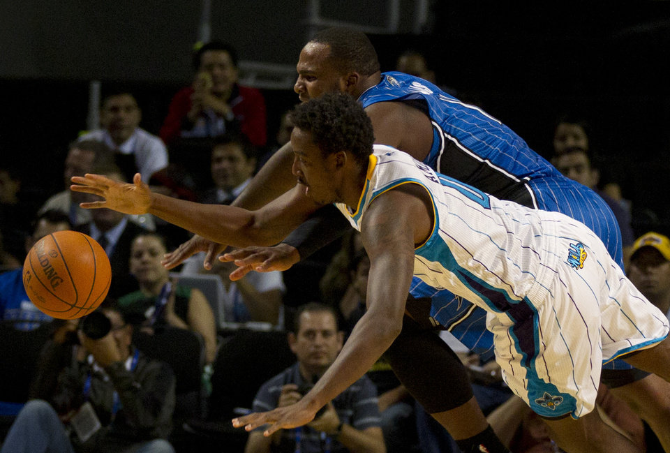 New Orleans Hornets' Al Farouq Aminu, front, and Orlando Magic Glen Davis (11) tussle for control of the ball during a NBA preseason basketball game in Mexico City, Sunday, Oct. 7, 2012. (AP Photo/Eduardo Verdugo)