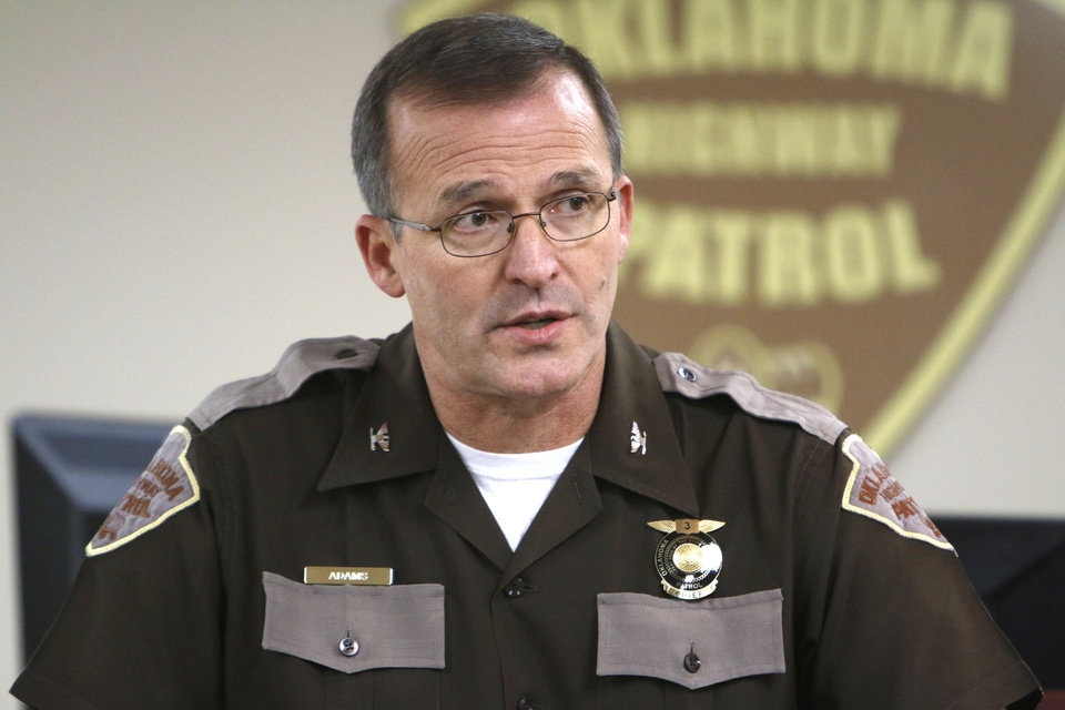 Photo -  Col. Ricky Adams, Oklahoma Highway Patrol's chief, speaks Monday about the arrest of trooper Eric Roberts during a news conference at patrol headquarters in Oklahoma City. Photo by Paul Hellstern, The Oklahoman   PAUL HELLSTERN -  Oklahoman