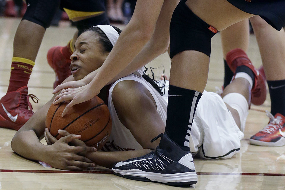 Photo - Stanford forward Erica McCall grabs a loose ball under USC players during the second half of an NCAA college basketball game in Stanford, Calif., Monday, Jan. 27, 2014. Stanford won 86-59. (AP Photo/Jeff Chiu)