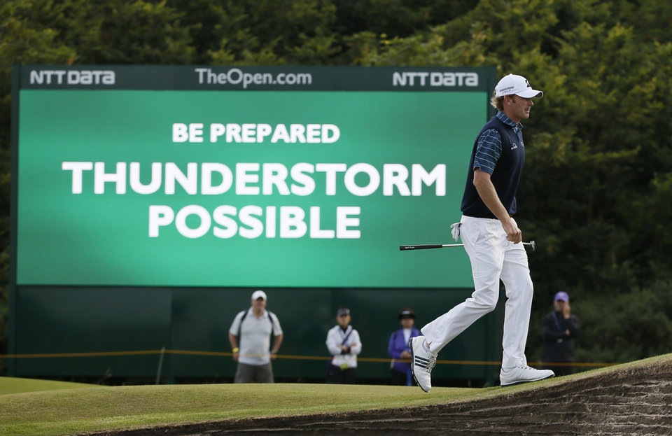 Photo - Brandt Snedeker of the US walks past a digital sign showing a weather warning on the second day of the British Open Golf championship at the Royal Liverpool golf club, Hoylake, England, Friday July 18, 2014. (AP Photo/Alastair Grant)