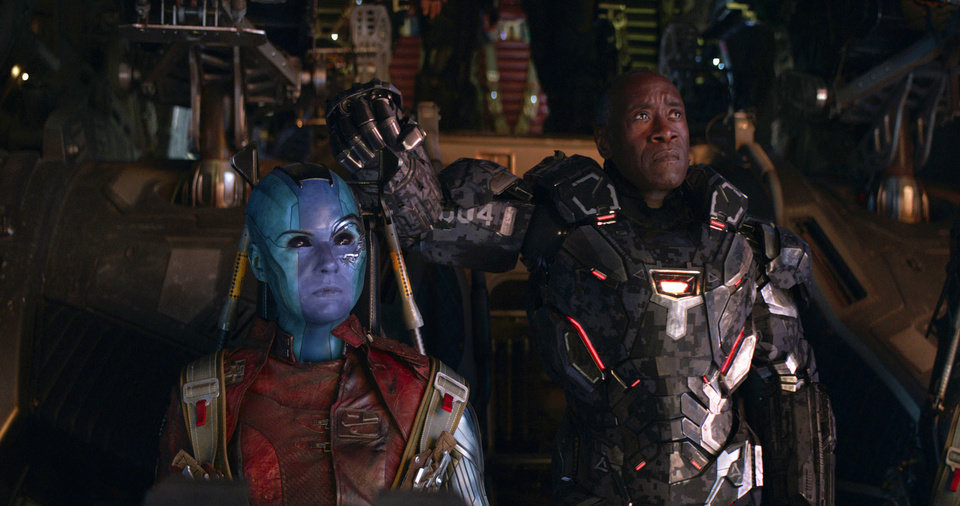Photo -  This image released by Disney shows Karen Gillan, left, and Don Cheadle in a scene from