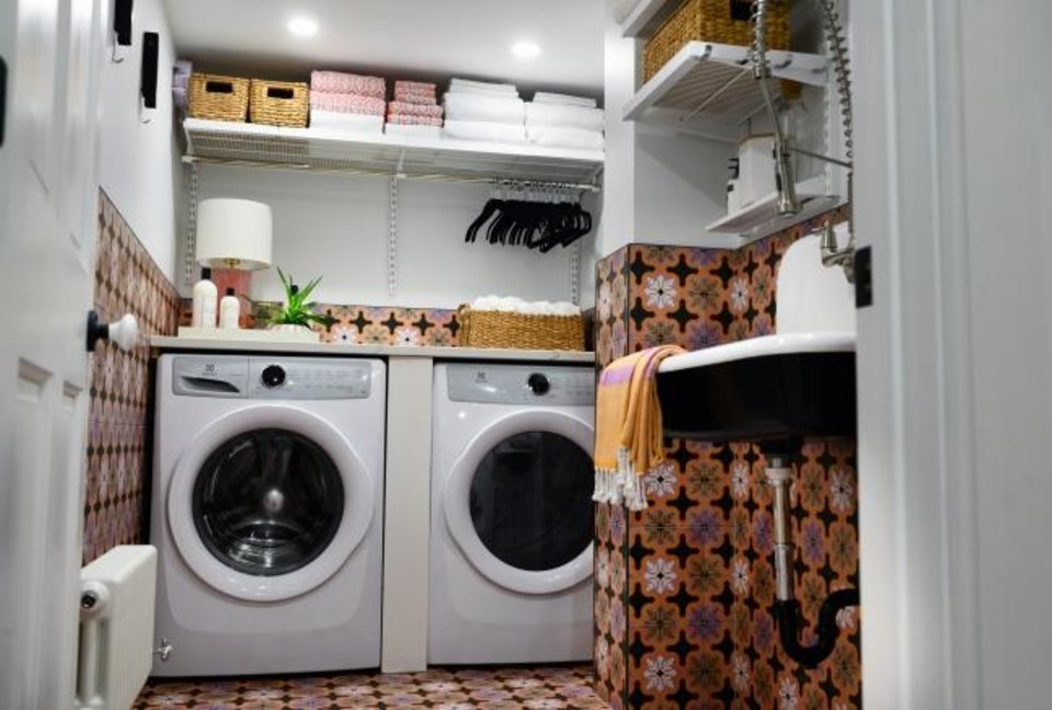 Photo -  Jessica Centella and Kiera Kushlan, of Residents Understood, designed a cool laundry space as part of a total basement renovation, using encaustic porcelain tiles and a farmhouse-style cast-iron sink. [SARAH L. VOISIN/THE WASHINGTON  POST]