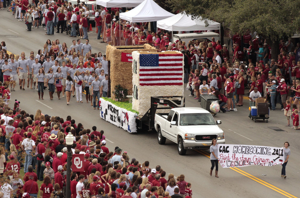 Photo - Floats travel down Boyd Street during the homecoming parade prior to the University of Oklahoma Sooners (OU) game with the Texas Tech University Red Raiders (TTU) on Saturday, Oct. 22, 2011. in Norman, Okla. Photo by Steve Sisney, The Oklahoman