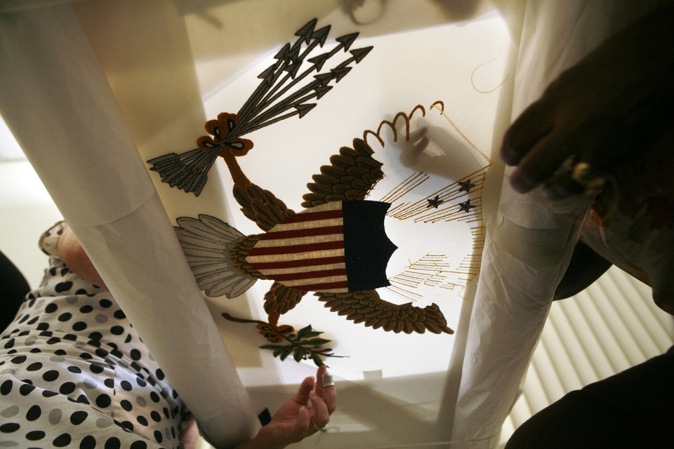 In this Tuesday, June 12 photo, Nereida Rivera, left and Christine Upchurch, right, both of Philadelphia, hand embroider a vice presidential flag at the Defense Logistics Agency in Philadelphia. The vice presidential flag takes the two fabric workers 35 days to be complete. About 10 miles from the house where Betsy Ross is believed to have sewn the first U.S. flag, Upchruch and Rivera are two of about a dozen seamstresses at a military supply operation who are the sole producers of the hand-stitched vice presidential banners.(AP Photo/Brynn Anderson)