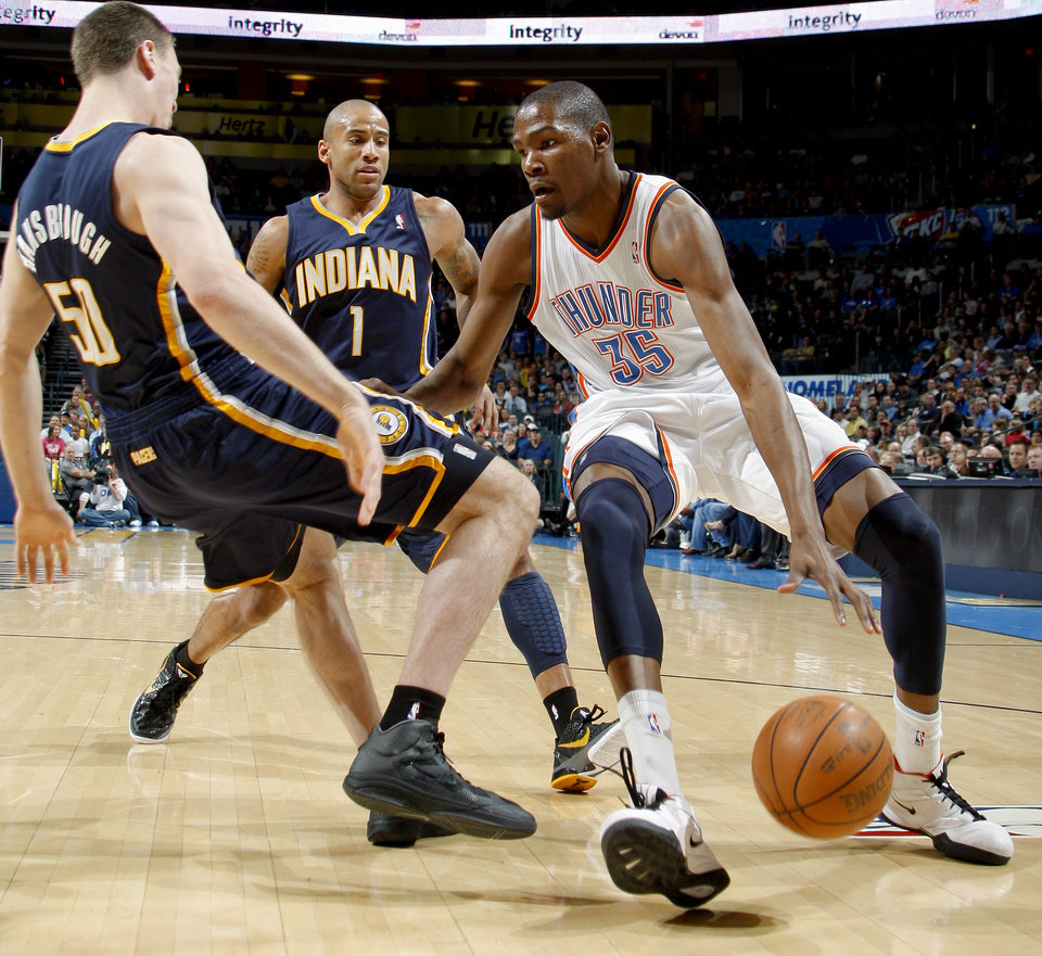 Oklahoma City\'s Kevin Durant (35) tries to get past Indiana\'s Tyler Hansbrough (50) and Dahntay Jones (1) during the NBA basketball game between the Oklahoma City Thunder and the Indiana Pacers at the Oklahoma City Arena, Wednesday, March 2, 2011. Photo by Bryan Terry, The Oklahoman