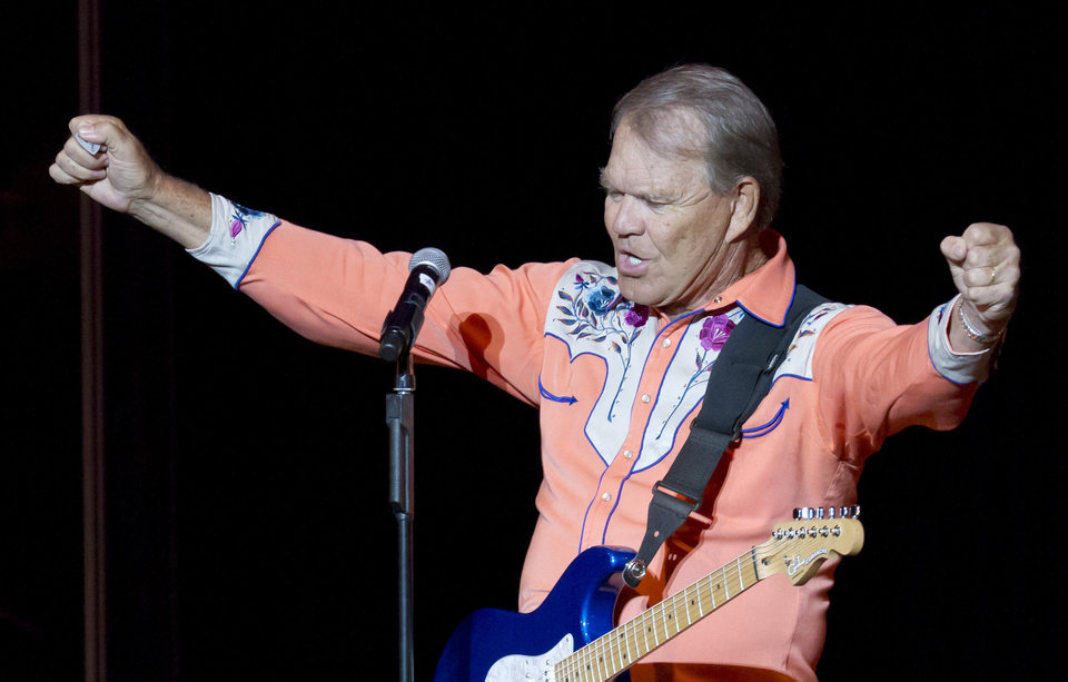 Photo - In this photo taken Thursday, Sept. 6, 2012, singer Glen Campbell performs during his Goodbye Tour in Little Rock, Ark. (AP Photo/Danny Johnston)