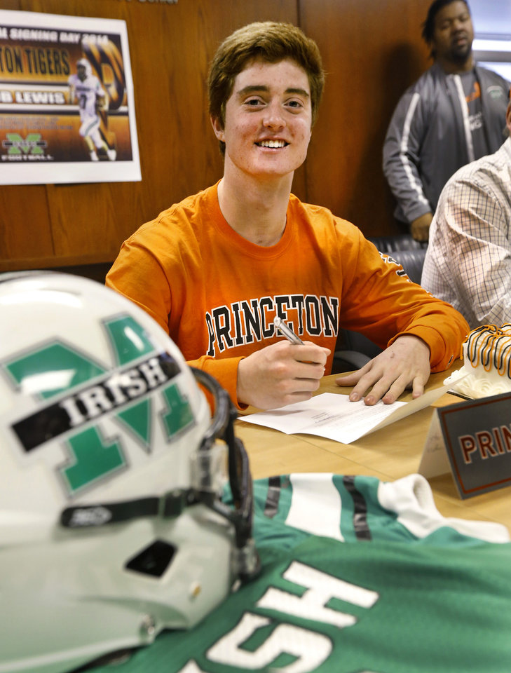 Photo - Irish senior quarterback  Jacob Lewis signed a letter of intent to play at Princeton during a signing day ceremony at Bishop McGuinness High School on Wednesday, Feb. 5, 2014.    Photo by Jim Beckel, The Oklahoman