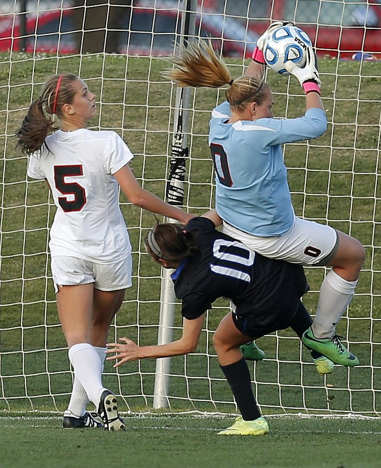 Photo - Carl Albert's Ashlyn makes a save beside teammate Jessica Titsworth as she comes down on Deer Creek's Kylee Johnson during the Class 5A girls state soccer championship between Deer Creek and Carl Albert in Norman, Okla., Saturday, May 17, 2014. Photo by Bryan Terry, The Oklahoman