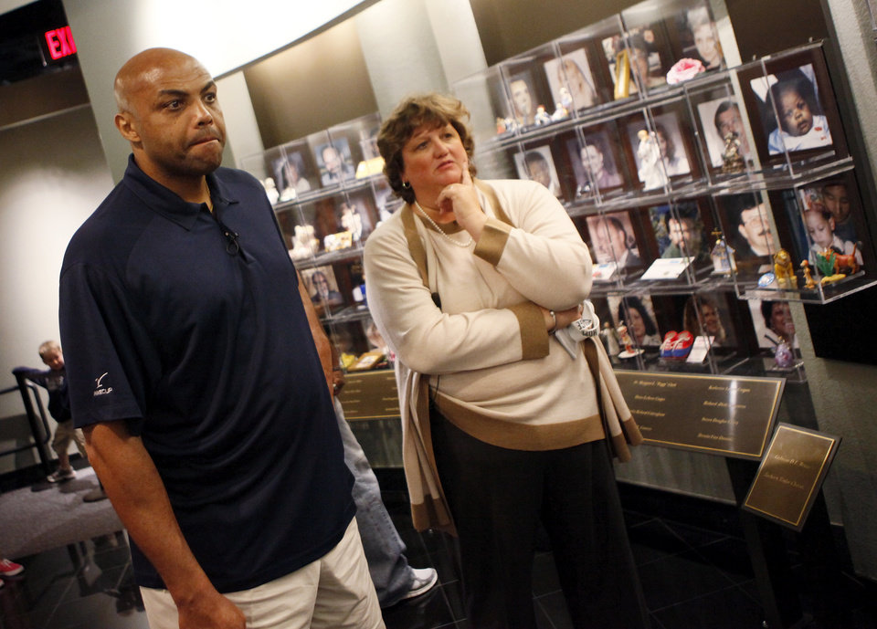 Photo - Charles Barkley tours the Oklahoma City National Memorial Museum with Kari Watkins, Oklahoma City National Memorial & Museum executive director, in Oklahoma City, Friday, June 1, 2012. Barkley visited the memorial as part of a tour of Oklahoma City. Photo by Nate Billings, The Oklahoman