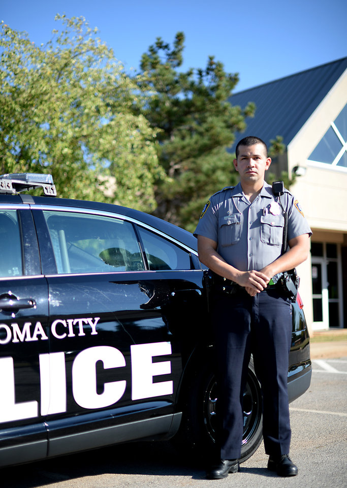 Photo -  Oklahoma City police officer Allan Cruz, shown in front of the Springlake Division, is one of the department's bilingual officers.