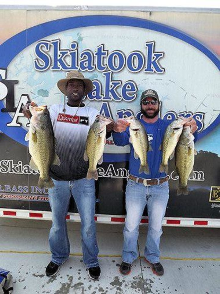 Rashaun Woods and Chris Savoie won a bass tournament on Lake Skiatook last weekend.
