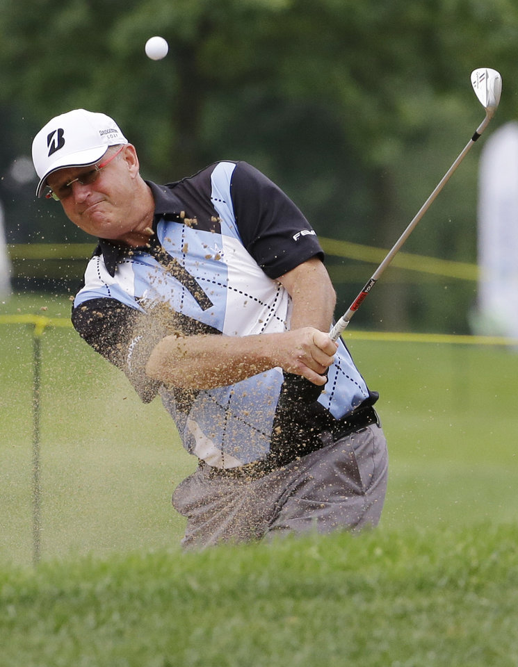 Photo - Sandy Lyle hits out of a bunker on the 17th hole during the second round of the Encompass Championship golf tournament in Glenview, Ill., Saturday, June 21, 2014. (AP Photo/Nam Y. Huh)
