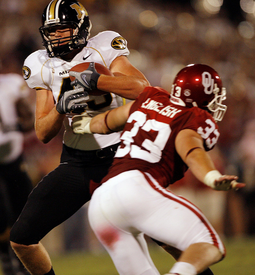 Photo - Oklahoma's Auston English (33) misses a tackle on Missouri's Chase Coffman (45) during the second half of the college football game between  the University of Oklahoma Sooners (OU) and the University of Missouri Tigers (MU) at the Gaylord Family Oklahoma Memorial Stadium on Saturday, Oct. 13, 2007, in Norman, Okla.By CHRIS LANDSBERGER, The Oklahoman