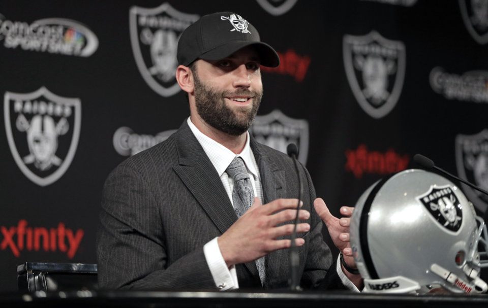 Photo - Oakland Raiders quarterback Matt Schaub  gestures while speaking during a news conference Friday, March 21, 2014, at the NFL football team's practice facility in Alameda, Calif. (AP Photo/Ben Margot)