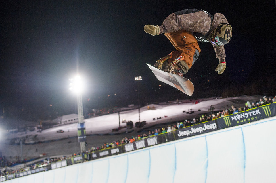 Photo - Danny Davis makes a 37.66 run before dominating the competition and winning gold with a 95.00 his second run during the Men's Snowboard SuperPipe finals at the 18th edition of the Winter X Games in Aspen, Colo. Sunday, Jan. 26, 2014.  (AP Photo/ The Gazette, Michael Ciaglo)