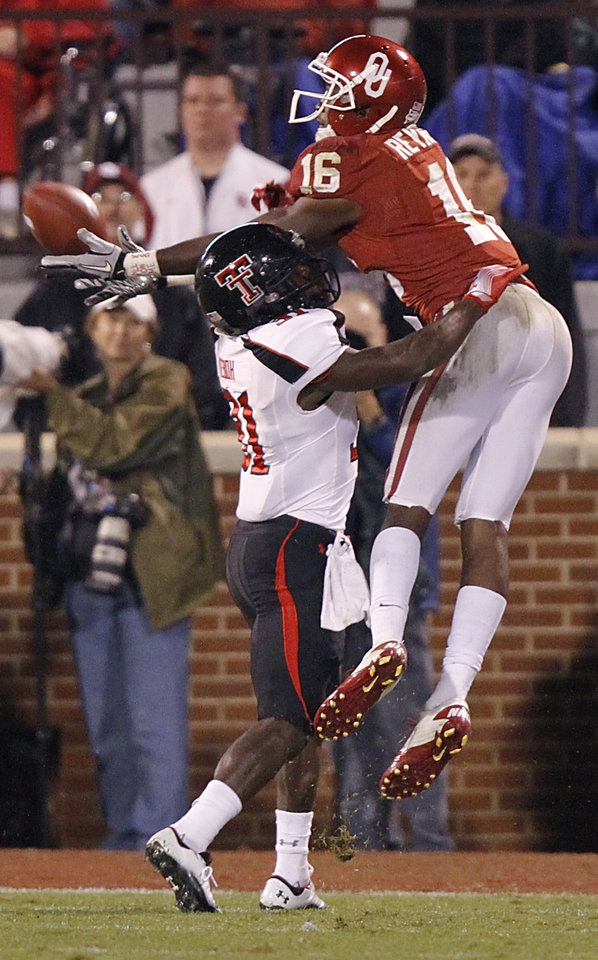 Texas Tech's Eugene Neboh (31) breaks up a pass for Oklahoma's Jaz Reynolds (16) during the college football game between the University of Oklahoma Sooners (OU) and Texas Tech University Red Raiders (TTU) at the Gaylord Family-Oklahoma Memorial Stadium on Saturday, Oct. 22, 2011. in Norman, Okla. Photo by Chris Landsberger, The Oklahoman