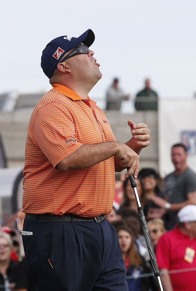 Photo - Kevin Stadler shouts after missing a birdie putt on the 18th green during the final round of the Phoenix Open golf tournament on Sunday, Feb. 2, 2014, in Scottsdale, Ariz.  Stadler made his par putt and won the tournament. (AP Photo/Ross D. Franklin)