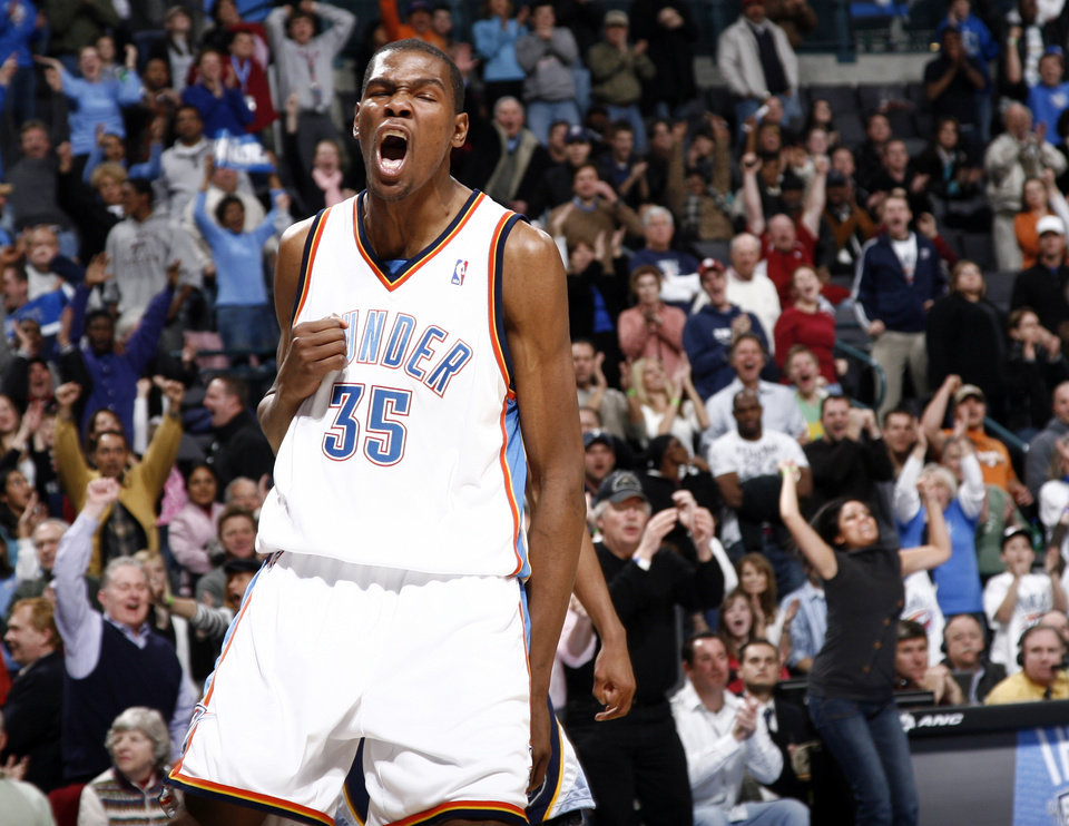 Photo - CELEBRATE / CELEBRATION / REACT / REACTION: Oklahoma City's Kevin Durant reacts after dunking the ball in overtime during the NBA basketball game between the Oklahoma City Thunder and the Memphis Grizzlies at the Ford Center in Oklahoma City, Wednesday, January 28, 2009. The Thunder won in overtime, 114-102. BY NATE BILLINGS, THE OKLAHOMAN ORG XMIT: KOD