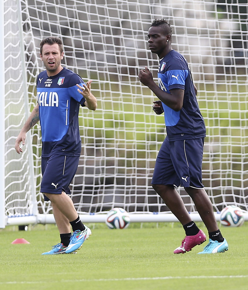 Photo - Italy forward Antonio Cassano, left, talks with his teammate Mario Balotelli during a training session for the upcoming World Cup at the Portobello training center in Mangaratiba, Brazil, Friday, June 6, 2014. Italy is part of Group D that includes Costa Rica, England and Uruguay. Italy will play England in Manaus in its opening match on June 14. (AP Photo/Antonio Calanni)