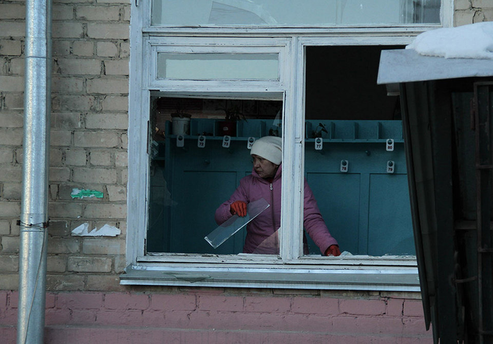 In this photo provided by Chelyabinsk.ru a woman cleans away glass debris from a window after a meteorite explosion over Chelyabinsk region on Friday, Feb. 15, 2013. A meteor exploded in the sky above Russia on Friday, causing a shockwave that blew out windows injuring hundreds of people and sending fragments falling to the ground in the Ural Mountains.  The Russian Academy of Sciences said in a statement hours after the Friday morning fall that the meteor entered the Earth's atmosphere at a speed of at least 54,000 kph (33,000 mph) and shattered about 30-50 kilometers (18-32 miles) above ground. The fall caused explosions that broke glass over a wide area. (AP Photo/ Yevgenia Yemelyanova, Chelyabinsk.ru) ORG XMIT: MOSB107