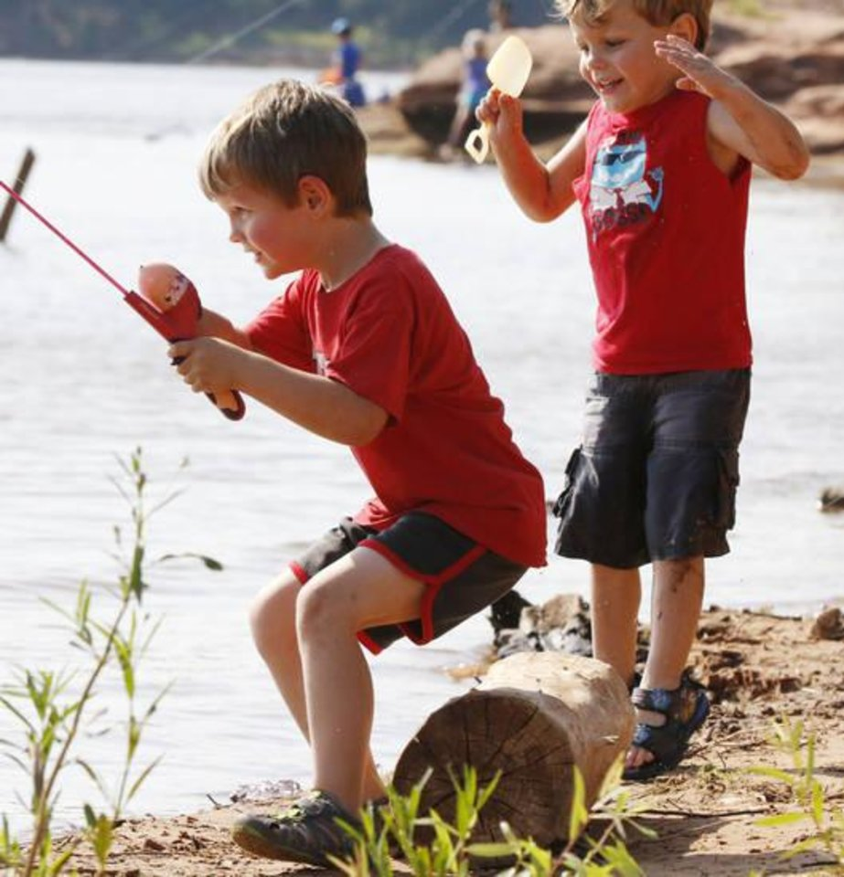 Photo -  Johnny Moore, 5, and his brother, Wyatt, 4, show their excitement when they think they have caught a fish. [PHOTO BY PAUL HELLSTERN, THE OKLAHOMAN}