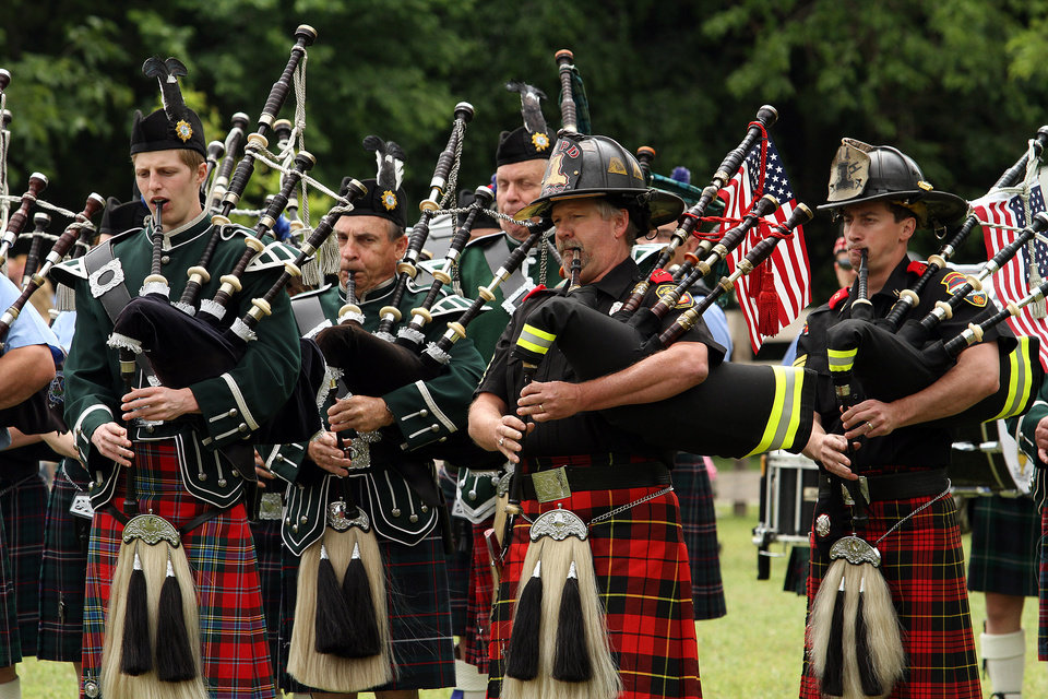 Photo - Members of the Pipe and Drums of the Highlands of Oklahoma City and the Oklahoma Fire Pipe and Drum bands perform during the Iron Thistle Festival in Yukon, Saturday, April 28th, 2012. PHOTO BY HUGH SCOTT, FOR THE OKLAHOMAN    ORG XMIT: KOD
