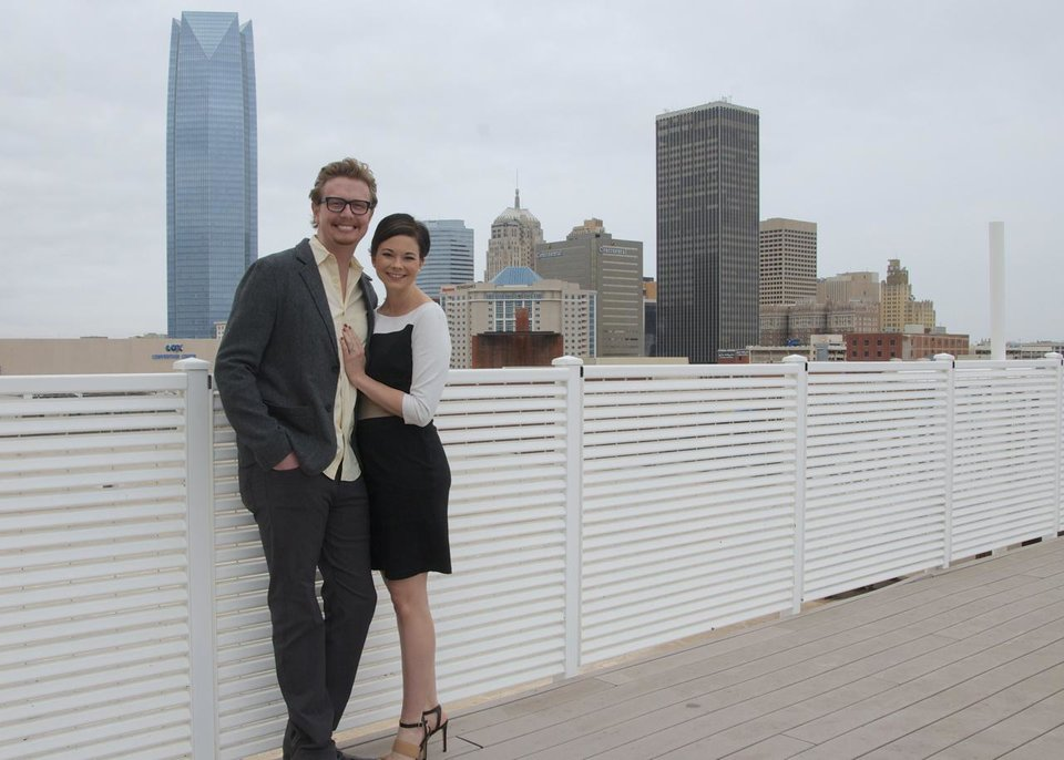 Photo -  J.D. and Jennifer Upton have a close view of the downtown Oklahoma City skyline from the rooftop terrace of Centennial Lofts at Bricktown, 200 S Oklahoma Ave., where they have lived for three years. The Oklahoman      -  The Oklahoman