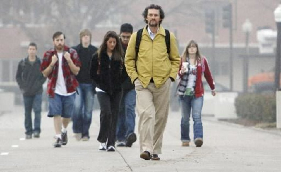 File photo - Robert Scafe, San Jose, Calif. walks to class as University of Oklahoma students return for the spring semester on Tuesday, Jan. 19, 2010, in Norman, Okla. Photo by Steve Sisney