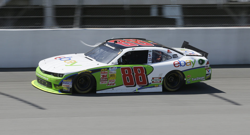 Photo - Dale Earnhardt Jr., drives during the NASCAR Nationwide series auto race at Michigan International Speedway in Brooklyn, Mich., Saturday, June 14, 2014. (AP Photo/Carlos Osorio)