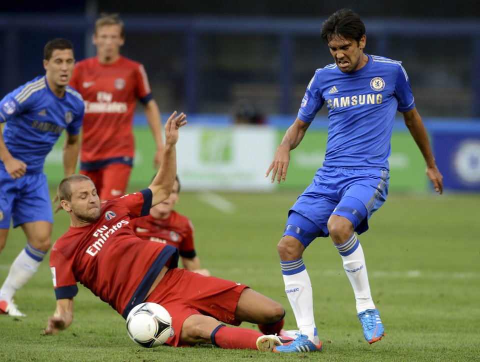 Chelsea FC's Paolo Ferreira, right, and Paris Saint-Germain's Mathieu Bodmer go for the ball during the first half of their exhibition soccer match at Yankee Stadium in New York, Sunday, July 22, 2012. (AP Photo/Henny Ray Abrams)