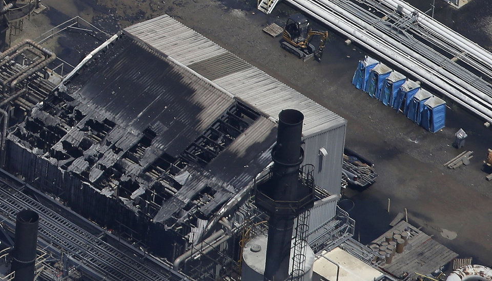 Photo - Melted portable toilets are seen at a chemical plant fire in this aerial photo about twenty miles southeast of Baton Rouge, in Geismer, La., Thursday, June 13, 2013. The plant makes highly flammable gases that are basic building blocks in the petrochemical industry. (AP Photo/Gerald Herbert)