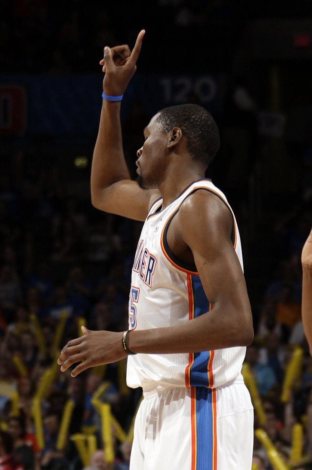 Oklahoma City's Kevin Durant (35) celebrates a three-point shot during the NBA basketball game between the Oklahoma City Thunder and the Sacramento Kings at Chesapeake Energy Arena in Oklahoma City, Tuesday, April 24, 2012. Photo by Sarah Phipps, The Oklahoman.