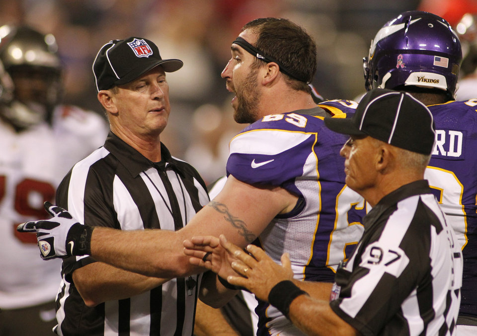 Photo -   Minnesota Vikings defensive end Jared Allen argues with officials after getting in a tussle with Tampa Bay Buccaneers tackle Donald Penn during the second half of an NFL football game Thursday, Oct. 25, 2012, in Minneapolis. (AP Photo/Andy King)