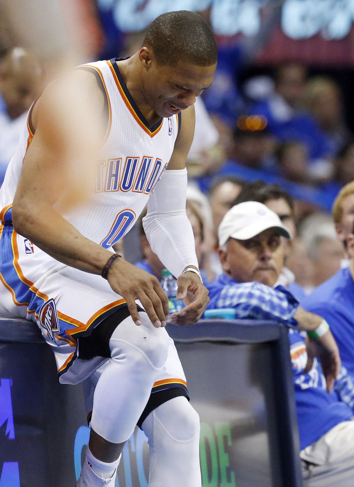In this photo taken Wednesday, April 24, 2013, Oklahoma City Thunder guard Russell Westbrook grabs his right knee during the second quarter of Game 2 of a first-round NBA basketball playoff series against the Houston Rockets in Oklahoma City. Westbrook, who remained in the game, will have surgery to repair a torn meniscus in his right knee and be out indefinitely, dealing a harsh blow to the City Thunder's championship chances. (AP Photo/Sue Ogrocki)