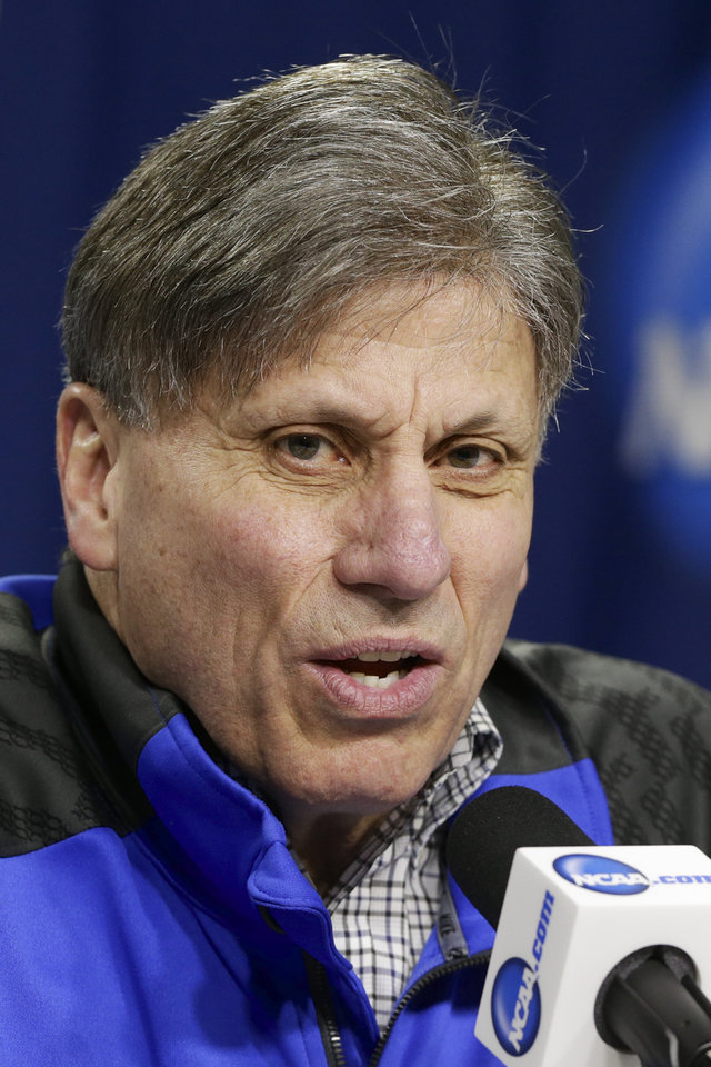 Photo - DePaul coach Doug Bruno answers a question during a news conference in Lincoln, Neb., Friday, March 28, 2014. DePaul will play Texas A&M in an NCAA women's basketball tournament regional semifinal on Saturday. (AP Photo/Nati Harnik)