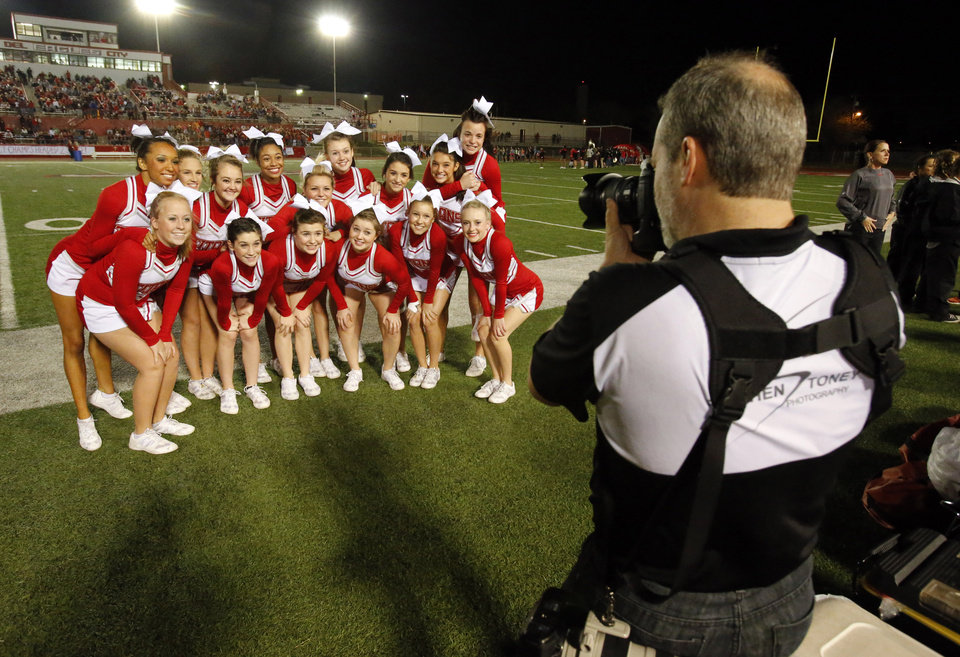 Photo - Carl Albert cheerleaders pose for a photograph before their Titans play the Del City Eagles in Class 5A first round playoffs high school football on Friday, Nov. 9, 2012 in Del City, Okla.   Photo by Steve Sisney, The Oklahoman