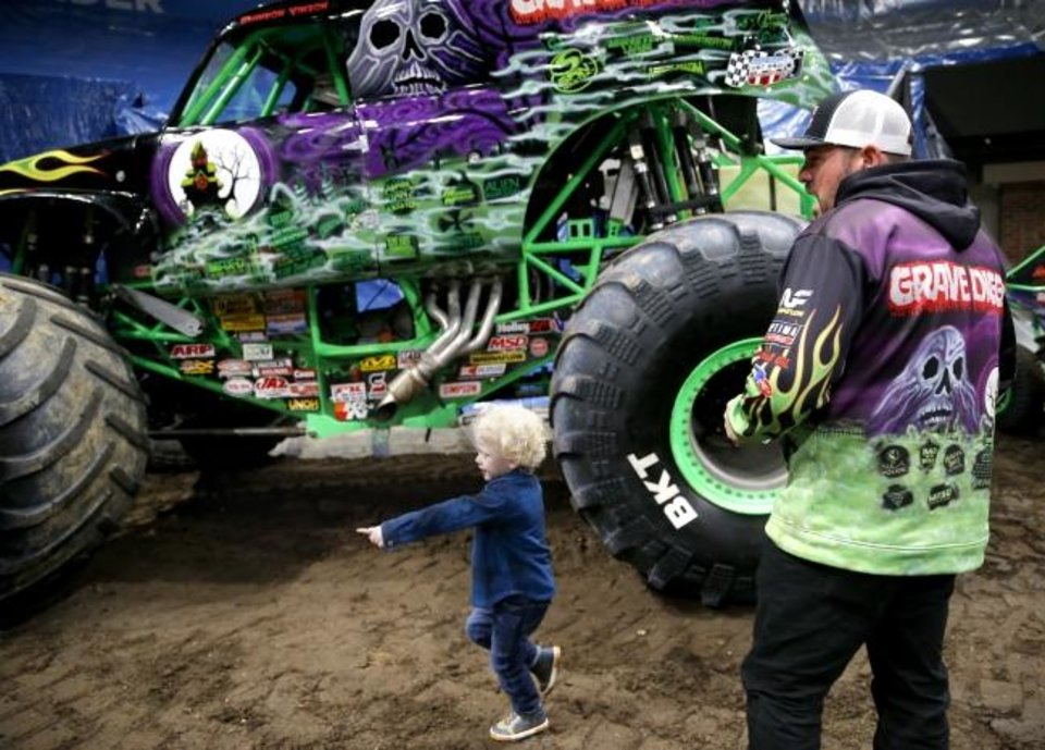 Photo -  Monster Jam driver Grave Digger, Brandon Vinson, walks with Ryker Ammons, 4, of Yukon, Okla., during a special meet and greet at Chesapeake Energy Arena in Oklahoma City, Friday, Feb. 14, 2020.  [Sarah Phipps/The Oklahoman]