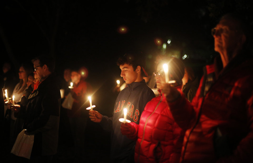Supporters hold candles during a candlelight vigil in Edmond to send a message of hope and recovery for people who live with mental illness. PHOTO BY GARETT FISBECK, THE OKLAHOMAN. <strong>Garett Fisbeck - THE OKLAHOMAN</strong>